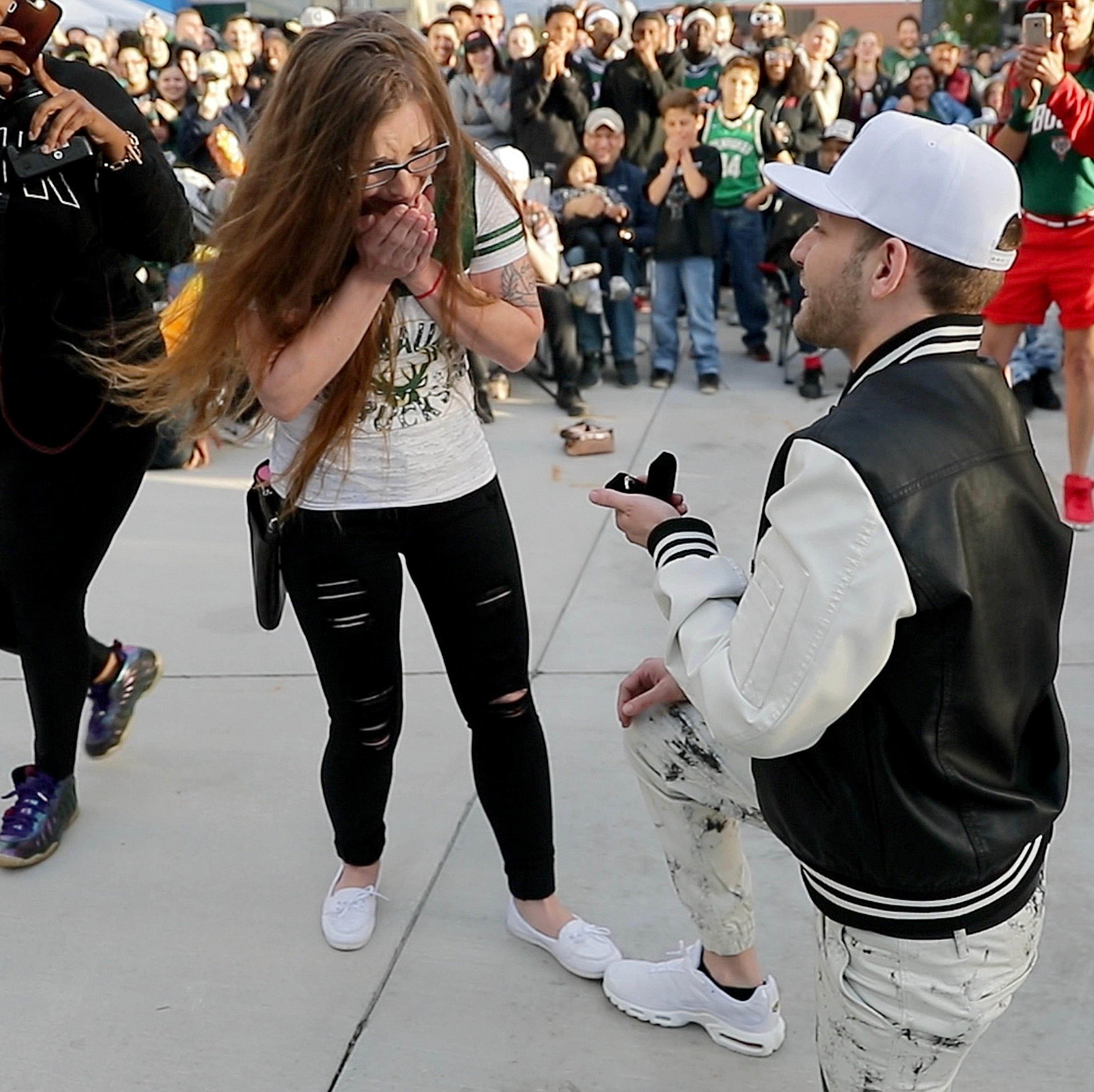 These two Bucks fans shared their proposal with thousands at a Fiserv Forum plaza playoffs watch party