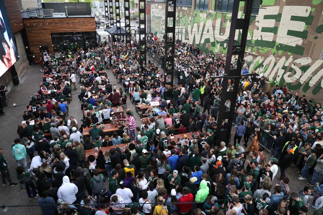 Milwaukee Bucks fans fill the beer garden area Sunday.