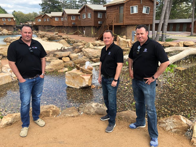 Brothers Dave, Adam and Rich Makowski (from left to right) have put in what they describe as a natural lagoon at their American Resort in the Wisconsin Dells. It has 1,500 plants in a wetland bog that cleanse the 250,000 gallons of water in the lagoon.