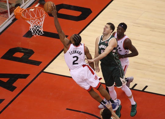 Raptors forward Kawhi Leonard  dunks in the second overtime after stealing the ball.