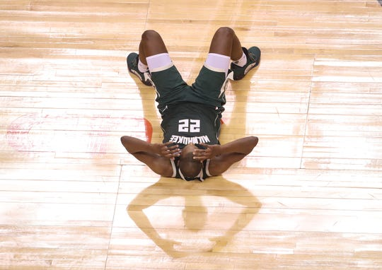 Bucks forward Khris Middleton is upset after missing a three-point shot late in the fourth quarter that would have given the Bucks a one-point lead.