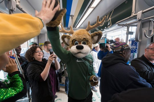 STANDALONE PHOTO -- Milwaukee Bucks mascot Bango greets passengers.