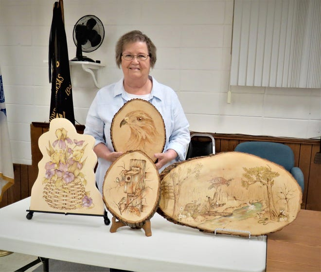 Myrna McCurley is the North Arkansas Woodcarver's Club Featured Carver displaying some of her woodcarving art that were on display at the Woodcarver's Show at the Baxter County Fair Grounds. Those interested in learning woodcarving should visit the Ozark VFW Post 3246 on Thursday mornings,just west of the fire station at 7th and Gray streets in Mountain Home to attend an NAWC meeting.