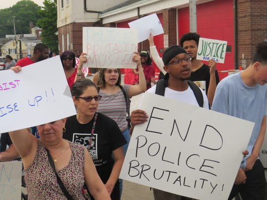 About 50 protesters march in Dover Sunday following the release of a video that shows a Dover officer punching a man in the face while he appeared to be resisting arrest early that morning, but was immobilized by other officers. May 19, 2019