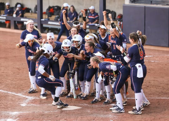 Auburn's Bree Fornis (15) celebrates with teammates after hitting a home run against Arizona on Saturday, May 18, 2019, in Tucson, AZ.