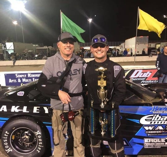 Jackson Boone and his father Clay Boone celebrate a podium finish at an Alabama racetrack in March.