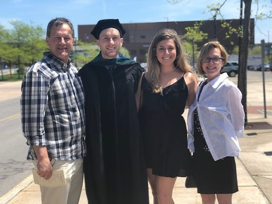 Brady Gaulke graduated from the University of Buffalo last year. He is pictured here with his girlfriend, Brittany Ciullo, and his parents.