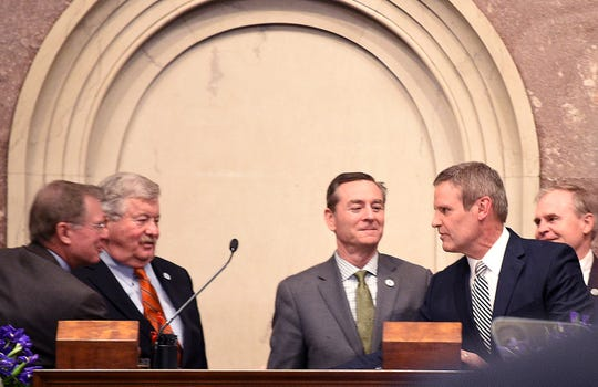 Gov. Bill Lee is congratulated by lawmakers after giving his first State of the State speech on March 4. Glen Casada, center, looks at Lee as other lawmakers shake Lee's hand.