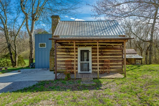 This 800-square-foot cabin adjacent to the main house has been completely remodeled into a one-bedroom space with a full kitchen, living room, screened-in back porch and a sleeping loft.