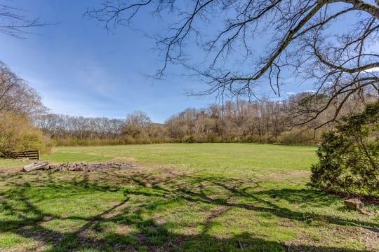 This home in Bethesda sits on just under six acres of land that is flat and would work great to house cattle or horses.