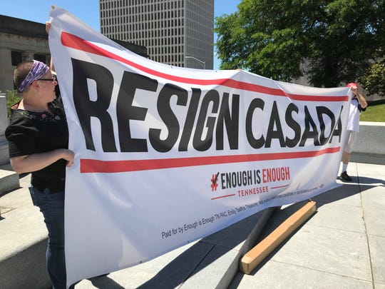 "Protesters hold a sign that reads, ""Resign Casada"" on Monday on the steps of the Tennessee state Capitol."