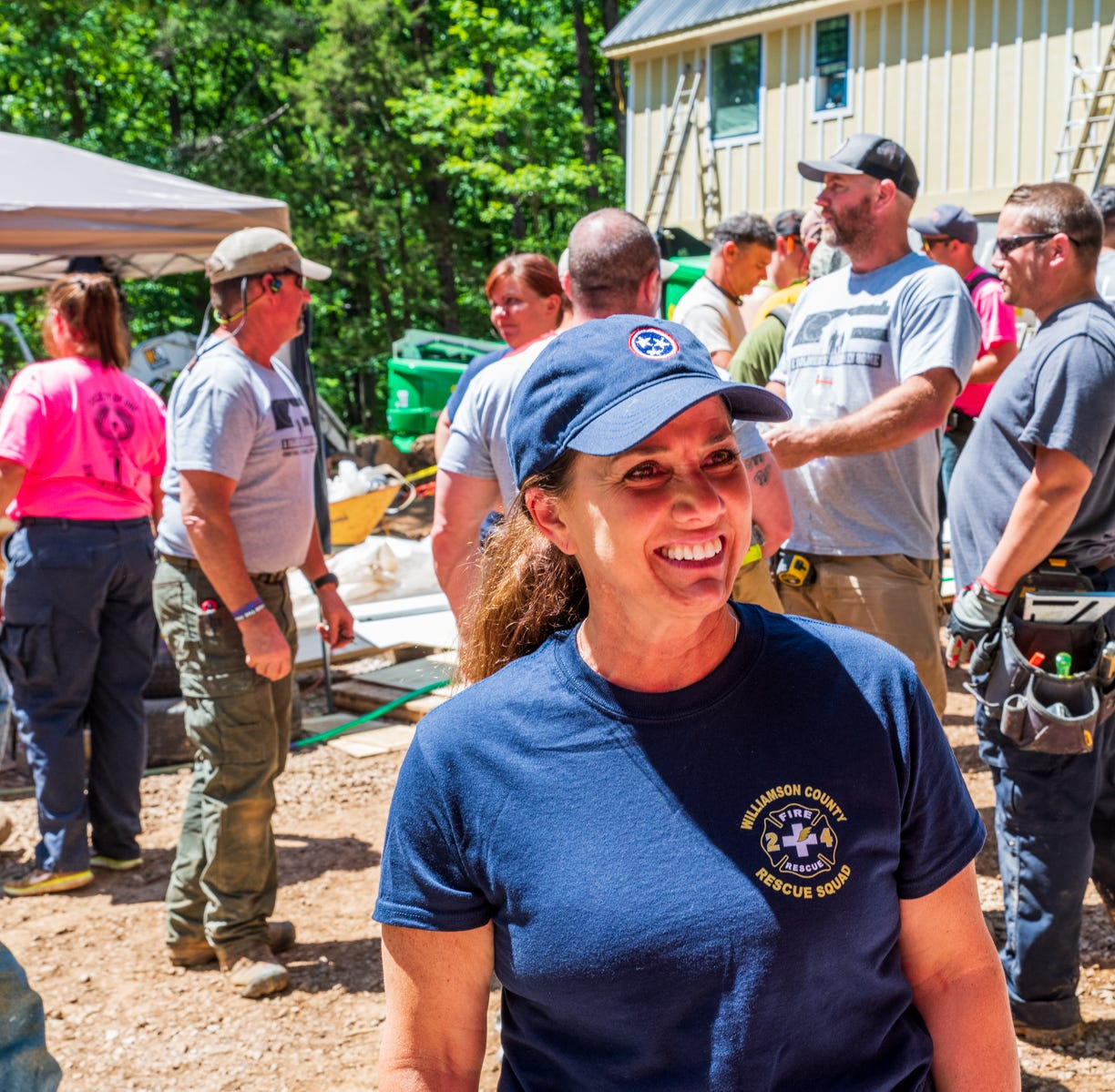 First Lady Maria Lee speaks with volunteers at a build May 14 with A Soldier's Journey Home.