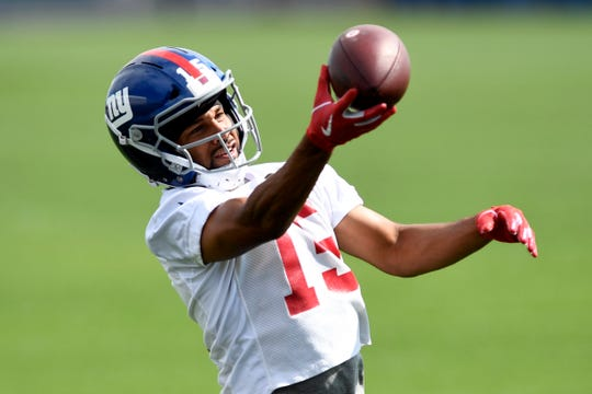 New York Giants wide receiver Golden Tate makes a one-handed catch during OTA's on Monday, May 19, 2019, in East Rutherford.