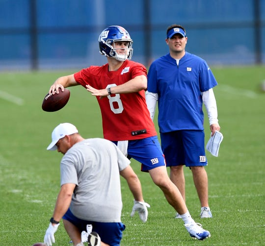New York Giants rookie quarterback Daniel Jones (8) throws during the Giants first OTA on Monday, May 19, 2019, in East Rutherford.