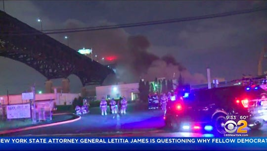 In this early Saturday, May 18, 2019 image made from video provided by WCBS TV, smoke billows over the Pulaski Skyway from a fire at the Alden Leads chlorine plant in Kearny, N.Y. Authorities say the fire has been brought under control, but road and bridge closures remained in effect and local residents were urged to remain indoors due to potential danger from fumes.