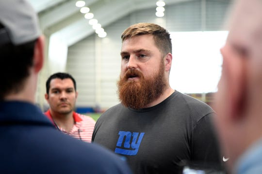 New York Giants tackle Mike Remmers talks to reporters after the first Giants OTA on Monday, May 19, 2019, in East Rutherford.