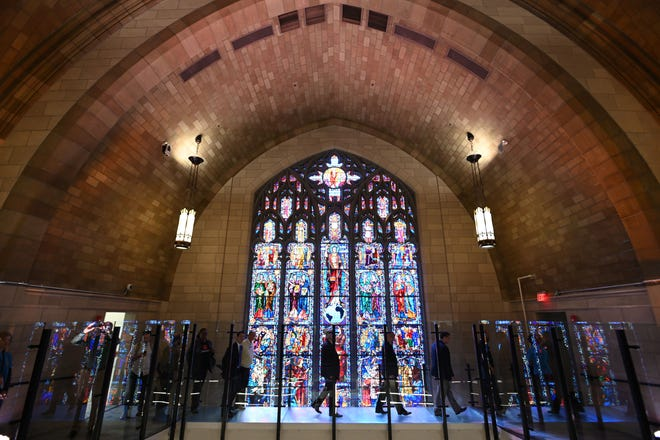 A tour of the Innovation Cathedral in Newark allows visitors to walk past the former church's spectacular stained glass windows.