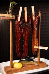 Chef David Burke's iconic clothesline bacon can be had at several of his NJ restaurants including Ventanas in Fort Lee