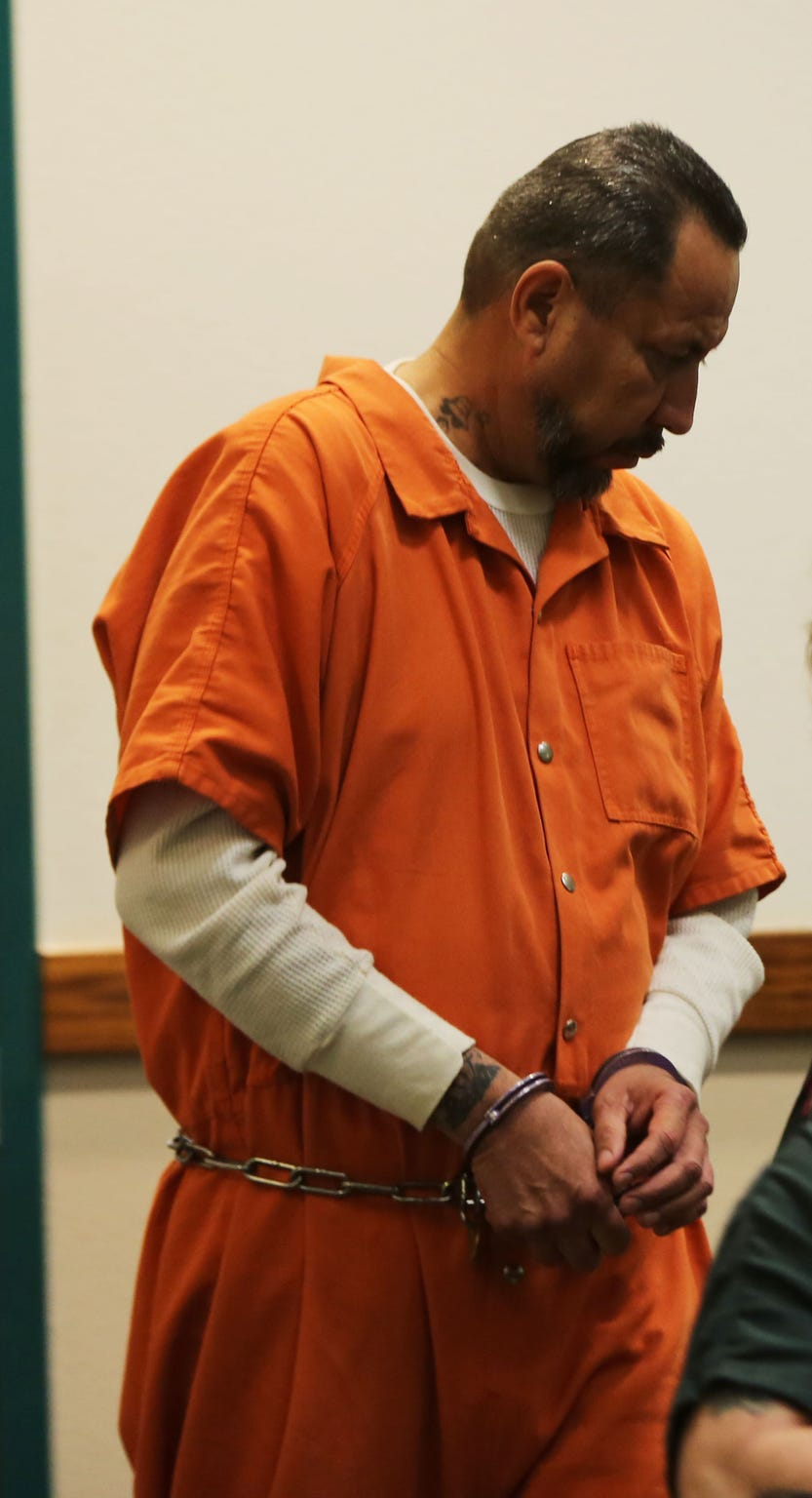 Las Cruces resident Gilbert Uranga, being led into courtroom six, for an arraignment on abuse charges, Monday May 20, 2019.