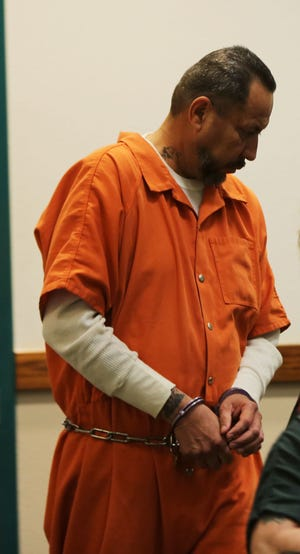 Las Cruces resident Gilbert Uranga is lead into an arraignment on abuse charges, Monday May 20, 2019.