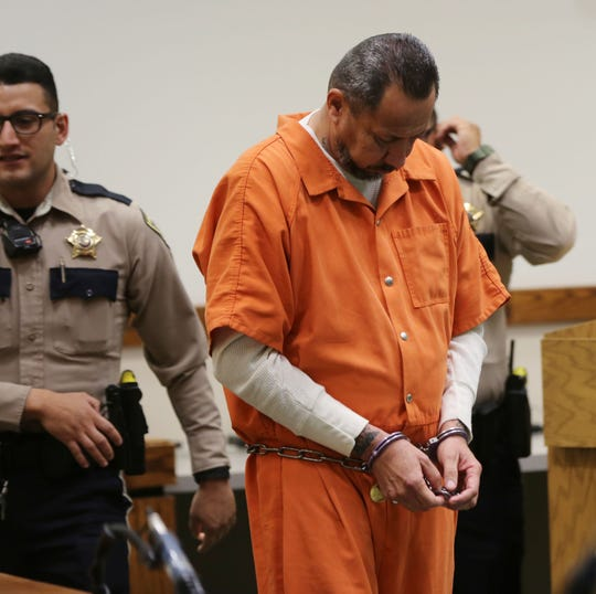 Las Cruces resident Gilbert Uranga walks to the podium in a Third Judicial District courtroom to be arraigned on allegations of sexual abuse on May 20, 2019.