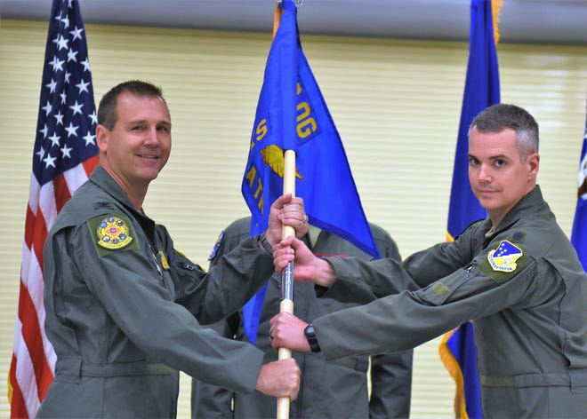Col. Jeffery Patton, 49th Operations Group commander, and Lt. Col. Trevor Laribee, 492nd Attack Squadron commander, pose for a photo during the 492nd Attack Squadron's activation and assumption of command ceremony, May 10, 2019, on March Air Reserve Base, Calif. The 492nd ATKS was reactivated on April 15, after over 60 years of lying dormant.