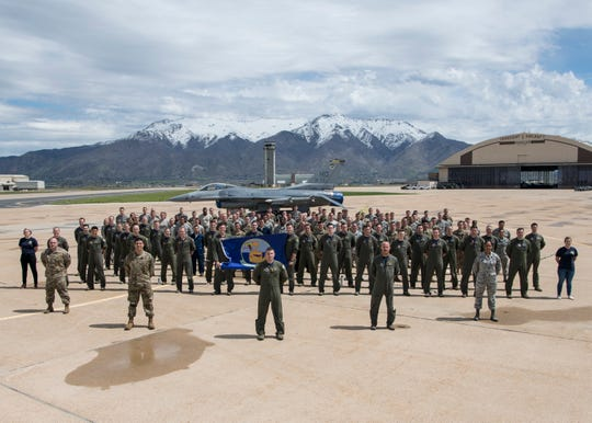 Members of the 311th Fighter Squadron pose for a squadron photo, April 25, 2019, on Hill Air Force Base, Utah. Between April 22 and May 3, the 311th FS conducted 174 sorties in support of student pilot training and dissimilar air combat training with the F-35 Lightning II.