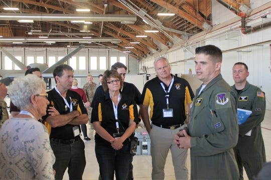 Operations Superintendent/MQ-9 Flight Examiner & Launch and Recovery Sensor Operator SMsgt. Shane tells a group of about 20 civilians an overview of the mission.
