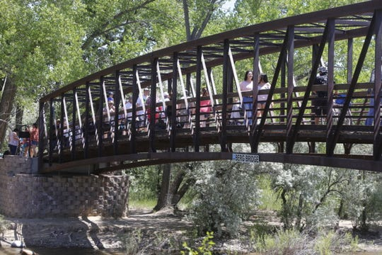 Visitors stroll across the Berg Bridge above the Animas River during the 2017 Riverfest.