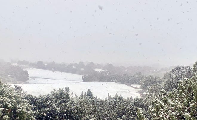 Snow covered the greens at Piñon Hills Golf Course in Farmington the morning of May 20 as light snow showers passed through town,