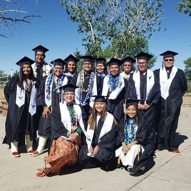 Graduates from Shiprock Northwest High School pose for a photo before their commencement ceremony at the Northwest High School Gym on May 18.
