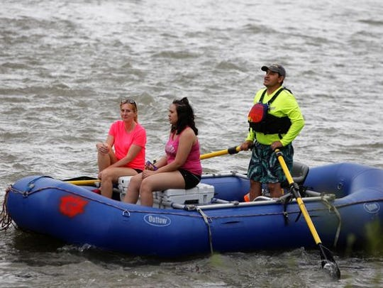 Rafters enjoy a trip down the Animas River during last year's Riverfest. The event returns this weekend to Animas and Berg parks in Farmington.