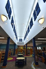 The new addition at the Salem-South Lyon Library has numerous different styles of lighting, a 20 foot-tall section with sound-absorbing acoustic tiles.