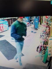 Oshkosh police are investigating a robbery of a South Main Street convenience store by two men and need help identifying the suspects.