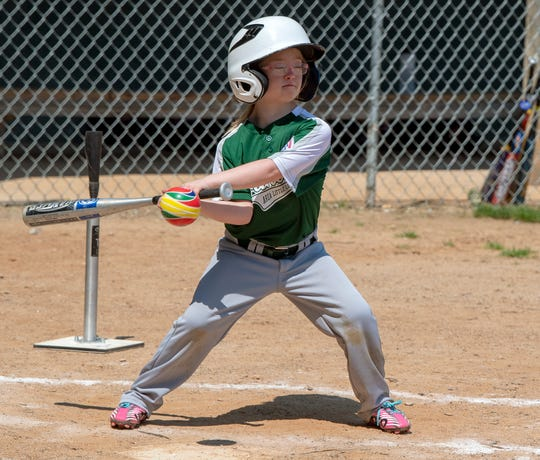 Kamdyn Dutterer takes a swing at a ball during a Challenger Division Little League game between Hanover and Dillsburg at the Eagle Field in Hanover.