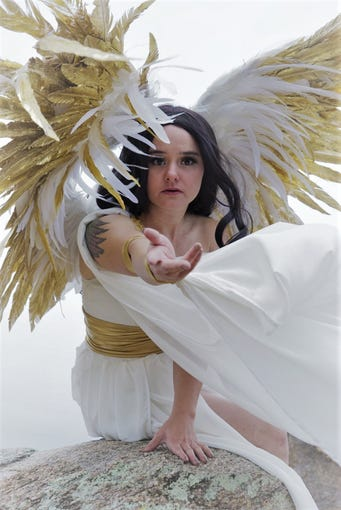 Costume creator Alexis Noriega models one of her wing creations.