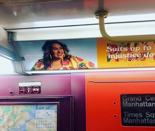 Rep. Alma Hernandez appeared in advertisements for clothing brand ELOQUII, which are shown here on a New York City subway car.