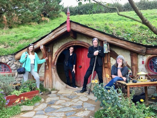 Trying Hobbit houses on for size at Hobbiton in Matamata, New Zealand with niece Isabel Trujillo, son Sawyer Bland and brother Danny Bland.