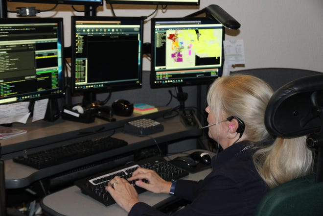 A dispatcher at the Buckeye Police Department's 911 Dispatch Center at work.
