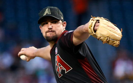 Arizona Diamondbacks starting pitcher Zack Godley throws to a San Francisco Giants batter during the first inning of a baseball game Saturday, May 18, 2019, in Phoenix.
