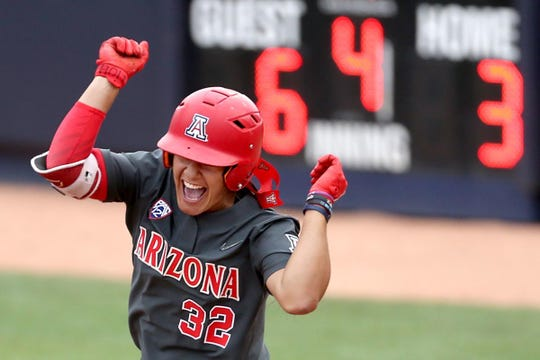 Arizona's Alyssa Palomino-Cardoza yells as she rounds first after smacking a three-run homer in the fourth inning of Sunday's win in Tucson.