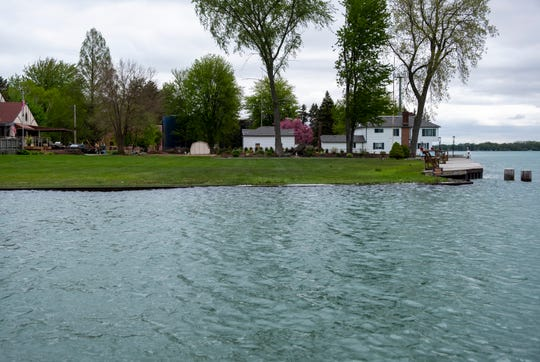 Water from the St. Clair River spills into a yard in Algonac Monday, May 20, 2019.