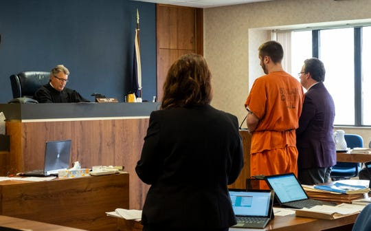 Genio Morgan, 22, second from right, stands before St. Clair County Circuit Judge Michael West during his sentencing hearing Monday, May 20, 2019 at the St. Clair County Courthouse in Port Huron.