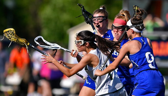 York Catholic's Olivia Staples is mobbed by Lampeter-Strasburg defenders during the District 3 Class 2-A girls' lacrosse semifinal, Monday, May 20, 2019. John A. Pavoncello photo