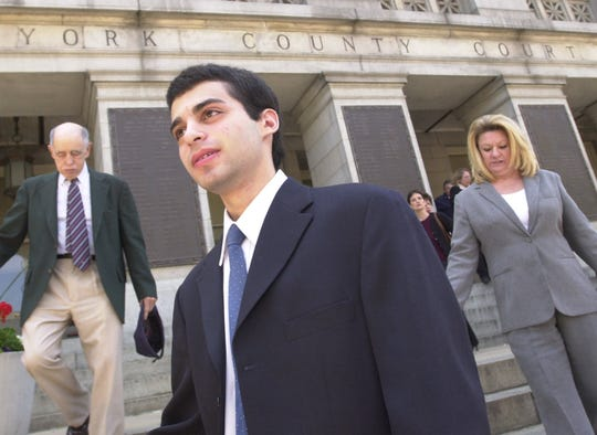 Zachary Witman leaves the York County Courthouse Monday, May 19, 2003.