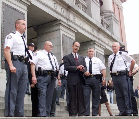 Surrounded by deputies, Ron Witman exits the  York County Courthouse Wednesday afternoon after a jury found his son, Zachary, guilty of first-degree murder in the death of Zachary's younger brother, Gregory, in 1998.  Witman refused to comment to the media following the trial Tuesday, May 20, 2003.