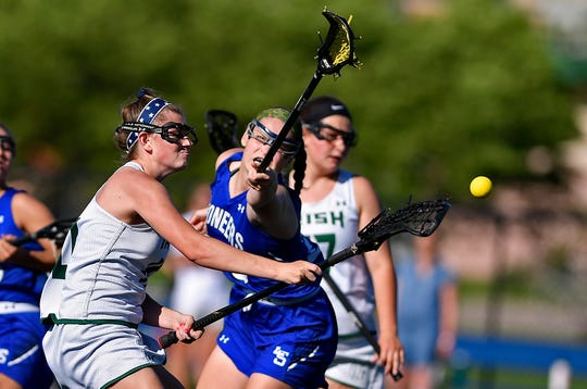 Sydney Mentzer of York Catholic shoots and scores against Lampeter-Strasburg during the District 3 Class 2-A girls' lacrosse semifinal, Monday, May 20, 2019. 