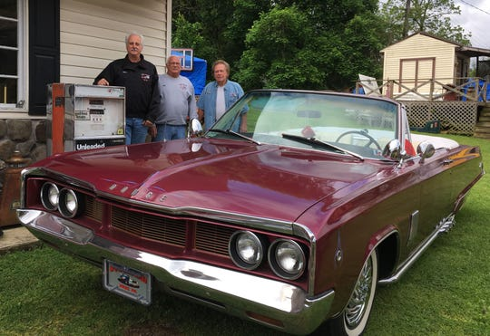 Left to right: Steve Smith, Rick Garver and Will Williams are shown with Williams' 1967 Dodge Polara convertible.