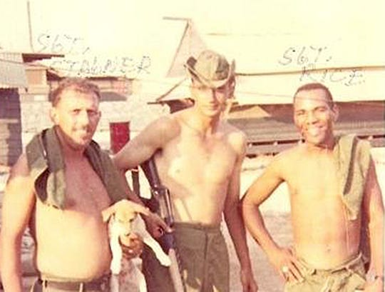 Calvin C. Rice Jr., right, in an undated photo while he was serving.