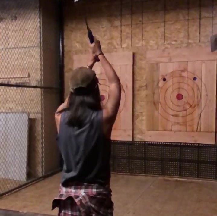 Watch woman hit bullseye at new Reno axe throwing bar